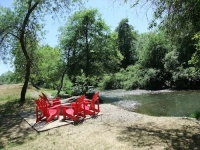 Adirondack chairs along the river at Truett-Hurst